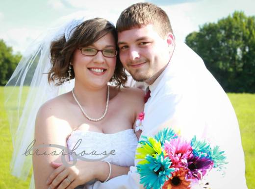 Rhiannon and her husband on their wedding day in 2013