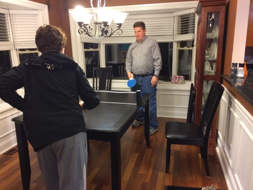 Greg playing ping pong with our son