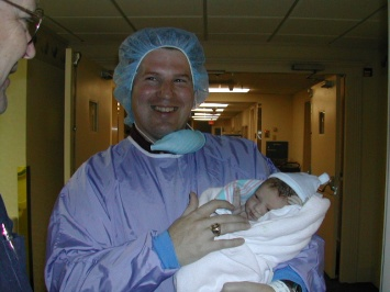 Greg holding our firstborn - 2002